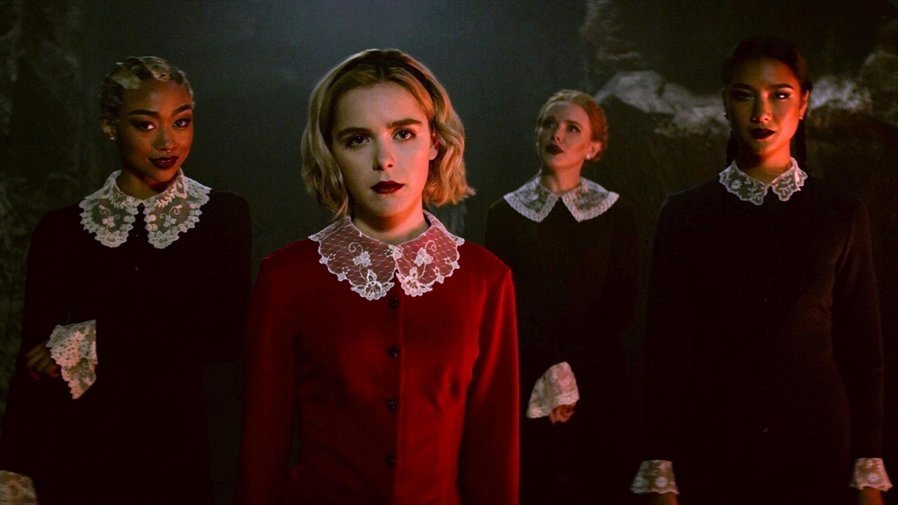 CHILLING ADVENTURES OF SABRINA  SEASON Season 1  EPISODE 2  PHOTO CREDIT Courtesy Of Netflix  PICTURED Tati Gabrielle, Kiernan Shipka, Abigail Cowen, Adeline Rudolph